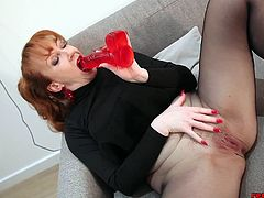Mature, British redhead whore loves fingering her juicy plump cunt lips through her nylons. She rubs a hard red dildo on her throbbing clit. Red gets so horny she has to shove the dildo deep into her wet pussy.