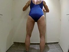 Trying swimsuit in toilet office