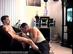 When straight boy Buzz returns for another round, I pull his pants down and wake the sleeping monster. He grabs the back of my head and fucks my face, so I pull my cock out to play. I rub our dicks together, and then have him kneel on the floor and jerk off. I see him eyeing my cock so I let him have it. For a novice, Buzz is pretty good at taking most of my 9 inches. I go back to servicing him, and when hes ready to blow Buzz grabs my head and shoots a huge load down my throat.