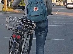 Candid ass in jeans - young girl riding bike