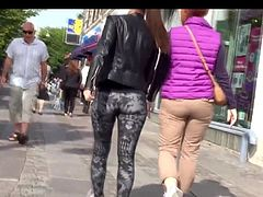 Perfectly fit round ass walking in patterned spandex