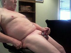 Jerking off his thick cock wearing cock rings