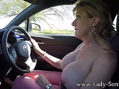Mature blonde Lady Sonia pulls out her big luscious tits and squeezes her already hard nipples while she is driving.