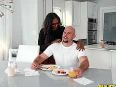 Jmac is down for the brown as well the white and everything else in between. This sexy Nubian princess with him today is serving up some breakfast with an extra-special treat. The lovely hottie gets under the table and starts sucking her lover's big dick, while he has his morning meal. Marry her fast!