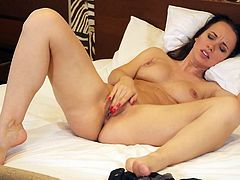 Naked milf beauty masturbating and moaning in bed