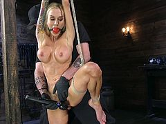Tied up fake tittied milf Sarah Jessie gets her pussy fucked with a long dildo stick