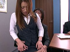 Japanese cutie likes to suck on two stiff cocks at once