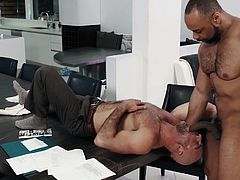 This office not only smells of sex, it is full of sex literally. Just look what these two do on the table... Join Noir Male and enjoy hot interracial gay sex session at its best! Hot stuff!