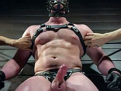 Join Men on Edge and enjoy one of the hottest bdsm threesomes which you have ever seen. Blake Hunter is in a special bondage device, with a leather mask on his face. He has no opportunity to move and he has to accept everything that is offered to him... even this incredible cock torture. Join for more!