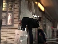 Candid Brunette shopping in Leather Pants and High Heels