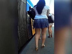 two miniskirt milf in public