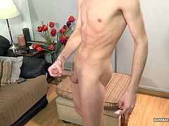 It doesnt take long for him to strip naked and show off the double headed dildo hell be shoving up his bubble butt. The Latin twink warms himself up with that big plastic cock and then turns his attention to working up a big boner. Once hard, the young man kicks back and strokes with determination until his belly is splattered with warm cum.