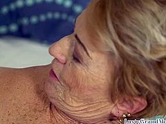 Dickriding grandma plowed by younger guy on the bed