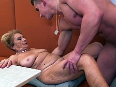 This busty mature with a hairy pussy gets fucked by her neighbour. The blonde granny seduced him with her perfect oral skills and saggy titties, that were bouncing with every stroke, when he was drilling her furry cunt from behind...