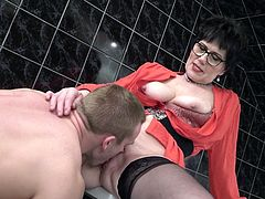 This busty mature knows alot about sex and how to seduce a guy. Her extensive life experience and perfect oral skills is her key to success. She drops down and sucks his cock, before she rides his dick and allows him to cum inside her mature pussy.