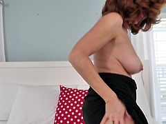 This hot redhead mature is so seducing, just look at her curvy body and big boobs with pink nipples. Her hairy pussy looks so inviting, that your cock will become rock hard in a minute. Pull your dick out of your pants and enjoy her company!