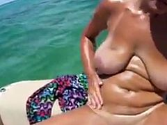 Sexy amateur chick with big boobs fingering on a boat