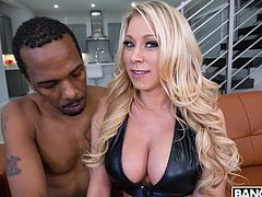 Sexy blonde Katie really needs this big black cock. She has a firm grip on the bbc, as she tugs hard and fast. The penis is so huge that it's as big as her forearm! The lovely milf slobbers all over his dick and takes it deep down her throat.