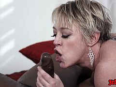 Is having a nice huge phat black monster of a cock to play with . There she is handling that huge thing without breaking a single drop of sweat