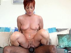 Redhead slipping in a black cock
